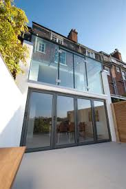 frameless glass bifold doors clifton view mansion glass extension in england by ar design