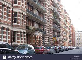 red brick victorian mansions on streets stock photo