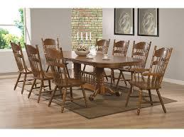 coaster brooks oak finish oval dining table with trestle base