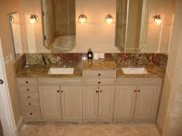 the finished product walnut and ivory travertine master bathroom