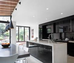 london kitchen cabinets black contemporary with modern pendant