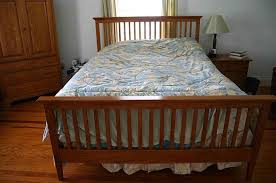 Brown Wood Bed Frame Brown Wooden Bed Frame With Bars On The Headboard And Blue White