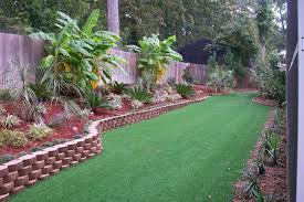 Rustic Landscaping Ideas For A Backyard Grass And Decorative Border For Tropical Backyard Landscaping