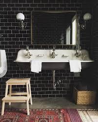 black bathroom ideas black subway tile spacious sink antique patterned rugs