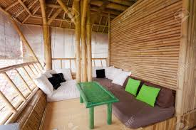 sitting area in bamboo house in bali stock photo picture and