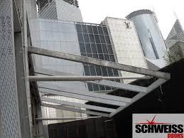 schweiss doors excels in giving your door a designer look hydraulic patio and garage doors with glass