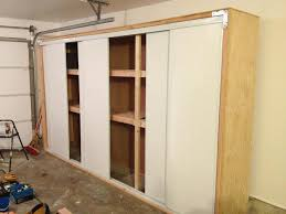 garage cabinets with sliding doors anthony valentino diy garage storage with sliding doors
