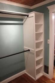 attach rods to side of a simple bookshelf to make a closet area in