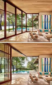 Sliding Glass Walls Texas Lakeside House Has An Exterior Of Wood Limestone And Glass