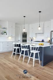 green kitchen cabinets with white island a brand new white kitchen with sw white and cyberspace