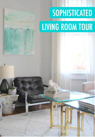 a moody and neutral living room tour metallic furniture living