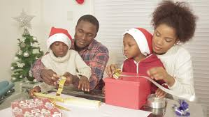 parents giving presents to children on r3d stock