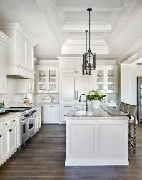 images of white kitchen cabinets with appliances in black hardware