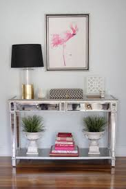 Mirrored Console Table Mirrored Console Table Decorated With Small Urns And Books With