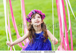 Royaltyfree Little girl on the swing little girl… 424497853 Stock
