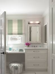 Silver Bathroom Vanities by Elegant Bathroom With Silver Moroccan Pouf Tucked Under A Floating