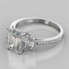 emerald cut three stone engagement ring with trapezoid accents