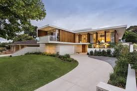 stained timber and stonework shape mid century modern aussie home