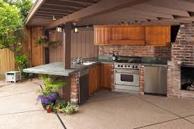 cool outdoor kitchen design in terrace as well stone backsplash