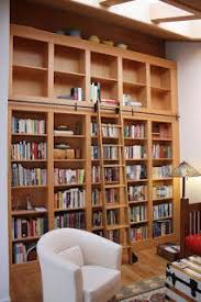 white custom bookshelf with ladder interior storage pinterest