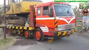 mitsubishi fuso 4x4 fuso self loader volvo ud trucks transporting excavator and