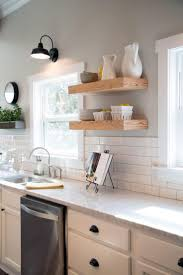 best 25 joanna gaines kitchen ideas on pinterest fixer upper floating shelves provide additional storage that s conveniently within reach