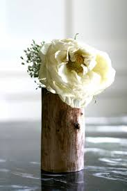 wood log vases diy log vases i did a weddings this year using this
