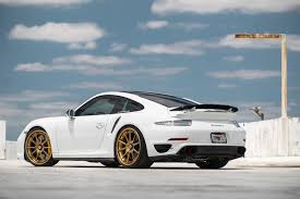 black porsche 911 turbo white porsche 911 turbo with gold velos designwerks wheels 29
