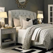 light gray tufted blanket white tufted bed headboard monochrome