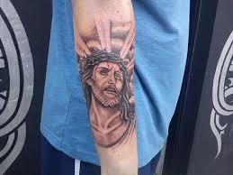 saintly jesus tattoos for 2013