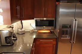 Kitchens Amp Kitchen Supplies Ikea by Finished Kitchen Ikea Adel Medium Brown Caesarstone Raven Quartz