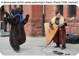 a dancing bear and its master performing in zazan russia 1836