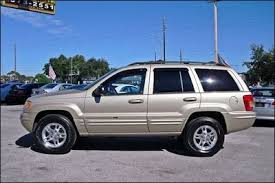 2000 gold jeep grand cherokee one of three grand cherokees black chagne and red wheels i