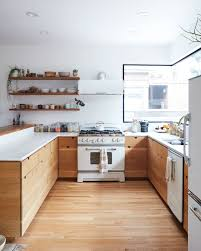 wood kitchen cabinets with white countertops the secret to white kitchen appliances look chic