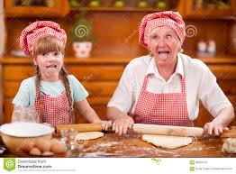 Kitch by Funny Grandmother And Little Granddaughter Lollygag In The Kitch