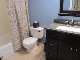 cheap bathroom remodel ideas white toilet on gray tile floor wall