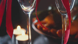 slowmotion romantic interior dim lights candles two glasses of