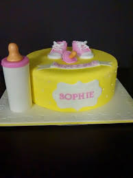 yellow and pink baby shower cake cherry with a cake on top