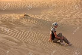 thar desert young woman sitting on dunes thar desert jaisalmer rajasthan