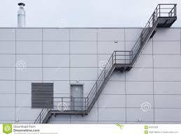 industrial stairway on steel modern tile facade stock photo