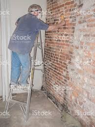 Exposed Brick Wall House Renovationsenior Man Scraping An Exposed Brick Wall Stock