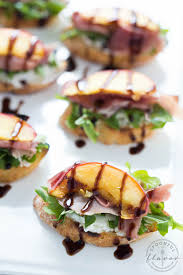 light appetizers for parties grilled peach crostini with arugula prosciutto and goat cheese is