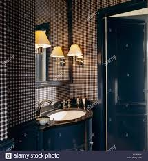 mirror and wall lights above vanity unit with integral basin in