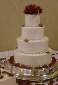 fountain style ivory wedding cake with malibu coral and
