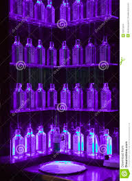 Decorate Shelves Multiple Gin Bottles In Purple Light Decorate Shelves In Bar In