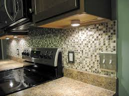 small ceramic tile backsplash under kitchen cabinet light bulbs