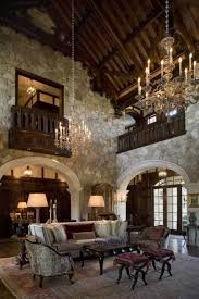 tudor style homes with high ceiling and double chandeliers and