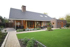 modern detached house overhanging gable roof bricks walls house