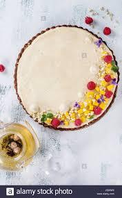 homemade chocolate tart decorated by mango raspberries mint