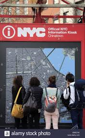 The Map Of New York by Visitors Looking At The Map Of New York City At The Wall Of